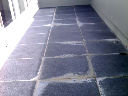 thick white crusts around the grout lines