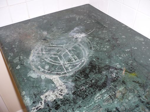 damage to this green marble benchtop
